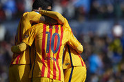 Luis Suarez (L) of Barcelona celebrates scoring his team's second goal with his teammates Lionel Messi and Neymar JR during the La Liga match between Levante UD and FC Barcelona at Ciutat de Valencia on February 07, 2016 in Valencia, Spain.
