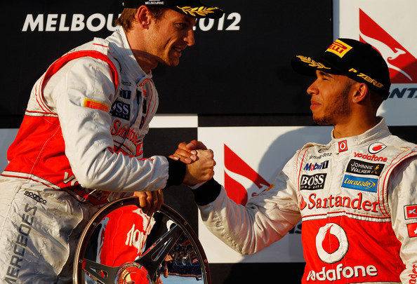 Lewis Hamilton Race winner Jenson Button (L) of Great Britain and McLaren celebrates with third placed Lewis Hamilton (R) of Great Britain and McLaren on the podium following the Australian Formula One Grand Prix at the Albert Park circuit on March 18, 2012 in Melbourne, Australia.