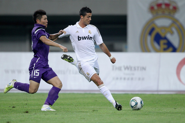 Tianjin Teda v Real Madrid - Real Madrid's China Tour [player,soccer,sports,soccer player,sports equipment,team sport,ball game,football player,football,sport venue,cristiano ronaldo,liao bochao,right,ball,left,water drop stadium,real madrid,tianjin teda,china tour,match]
