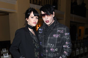 Lindsay Usich and Marilyn Manson attend the Libertine Fall 2019 Runway Show at Ebell of Los Angeles on April 26, 2019 in Los Angeles, California.