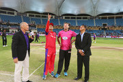 Opposing captains Virender Sehwag of Gemini Arabians and Jacques Kallis of Libra Legends perform the coin toss prior to the opening match of the Oxigen Masters Champions League 2016 between Libra Legends and Gemini Arabians on January 28, 2016 in Dubai, United Arab Emirates.