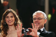 "Director Daniele Luchetti takes a photo as actress  Stefania Montorsi looks on attend the ""Our Life"" Premiere at the Palais des Festivals during the 63rd Annual Cannes Film Festival on May 20, 2010 in Cannes, France."