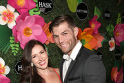 Liam McIntyre (R) and Erin Hasan attend the Lifetime Summer Luau on May 20, 2019 in Los Angeles, California.