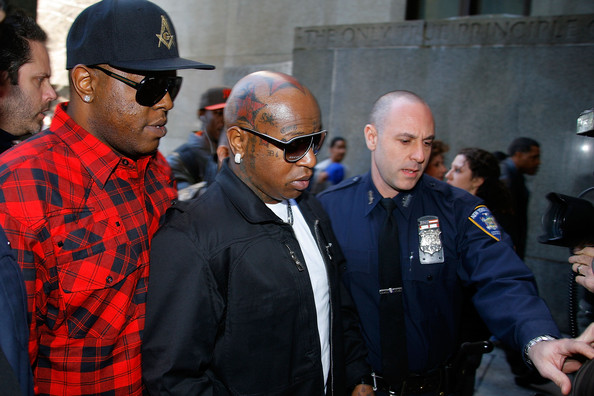 "Founders of Cash Money Records Ronald ""Slim"" Williams (L) and Bryan ""Birdman"" Williams arrive at New York State Supreme Court where Dwayne Carter, known as Lil Wayne, reported to begin serving a one-year prison sentence for possession of an illegal weapon on March 8, 2010 in New York City."