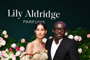 Lily Aldridge and Edward Enninful pose for a photo during the Lily Aldridge parfums launch event at The Bowery Terrace at the Bowery Hotel on September 08, 2019 in New York City.