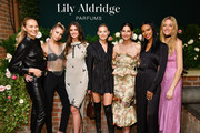 Romee Strijd, Stella Maxwell, Taylor Hill, Elsa Hosk, Lily Aldridge, Jasmine Tookes and Martha Hunt pose for a photo during the Lily Aldridge parfums launch event at The Bowery Terrace at the Bowery Hotel on September 08, 2019 in New York City.