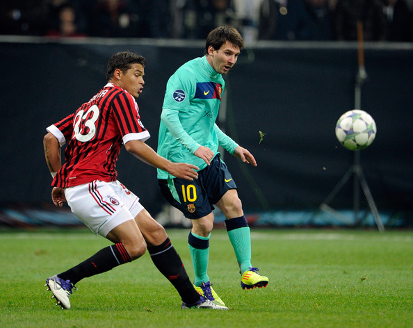 Lionel Messi Thiago Silva of AC Milan and Lionel Messi of FC Barcelona compete for the