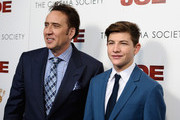 """Actors Nicolas Cage (L) and Tye Sheridan attend the """"Joe"""" screening hosted by Lionsgate and Roadside Attractions with The Cinema Society at Landmark Sunshine Cinema on April 9, 2014 in New York City."""