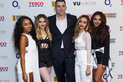 Leigh-Anne Pinnock, Perrie Edwards, Jade Thirlwall and Jesy Nelson of Little Mix pose with Nick Easter at the Nordoff Robbins Six Nations Championship Rugby Dinner at The Grosvenor House Hotel on January 14, 2015 in London, England.