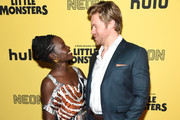 """Lupita Nyong'o and Alexander England attend the New York Premiere """"Little Monsters"""" at AMC Lincoln Square Theater on October 08, 2019 in New York City."""