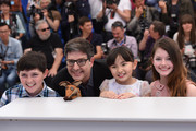 """(L-R) Riley Osborne, director Mark Osborne,  Rio Suzuki  and Mackenzie Foy attend the """"Little Prince"""" (""""Le Petit Prince"""") Photocall-  during the 68th annual Cannes Film Festival on May 22, 2015 in Cannes, France."""