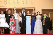 """(L-R) Florence Foresti, Masahiko Tsugawa, Rio Suzuki, Asaka Seto, Clara Poincare, Marion Cotillard, Charlotte Vandermeersch, Mackenzie Foy and Riley Osborne attend the Premiere of """"The Little Prince"""" during the 68th annual Cannes Film Festival on May 22, 2015 in Cannes, France."""