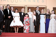 """(L-R) Andre Dussollier, Laurent Lafitte, Guillaume Gallienne, Florence Foresti, Masahiko Tsugawa, Rio Suzuki, Asaka Seto, Clara Pointcare, Mark Osborne, Marion Cotillard, Charlotte Vandermeersch and Mackenzie Foy attends the Premiere of """"The Little Prince"""" during the 68th annual Cannes Film Festival on May 22, 2015 in Cannes, France."""