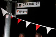 Liverpool FC players (L-R) Kolo Toure, Sheyi Ojo and Mamadou Sakho rename Caxton st as Anfield Road to celebrate the arrival of Liverpool FC on July 16, 2015 in Brisbane, Australia. Liverpool FC are in Queensland to play the Brisbane Roar at Suncorp Stadium on the first leg of their Australian tour