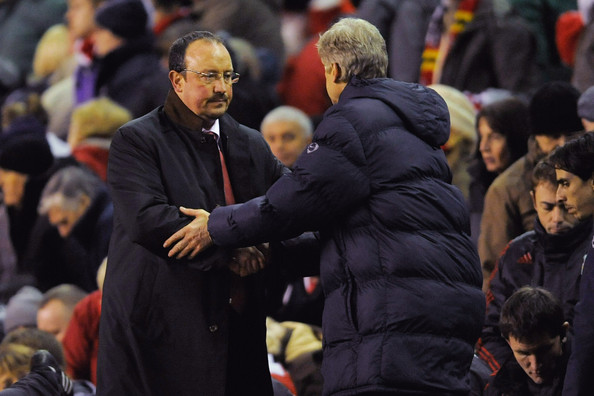 Liverpool Manager Rafael Benitez shakes hands with Arsenal Manager Arsene Wenger (R) at the end of the Barclays Premier League match between Liverpool and Arsenal at Anfield on December 13, 2009 in Liverpool, England.