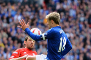 Maxi Rodriguez of Liverpool kicks the ball against the arm of Phil Neville of Everton during the FA Cup with Budweiser Semi Final match between Liverpool and Everton at Wembley Stadium on April 14, 2012 in London, England.