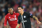 Angel Di Maria of Paris Saint-Germain is chased by Georginio Wijnaldum of Liverpool during the Group C match of the UEFA Champions League between Liverpool and Paris Saint-Germain at Anfield on September 18, 2018 in Liverpool, United Kingdom.