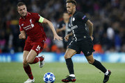 Neymar of Paris Saint-Germain passes the ball under pressure from Jordan Henderson of Liverpool during the Group C match of the UEFA Champions League between Liverpool and Paris Saint-Germain at Anfield on September 18, 2018 in Liverpool, United Kingdom.