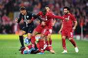 Neymar of Paris Saint-Germain battles with Georginio Wijnaldum and Jordan Henderson of Liverpool during the Group C match of the UEFA Champions League between Liverpool and Paris Saint-Germain at Anfield on September 18, 2018 in Liverpool, United Kingdom.