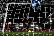 Neymar of PSG smashes the ball into the net after Kylian Mbappe of PSG had scored to make it 2-2 during the Group C match of the UEFA Champions League between Liverpool and Paris Saint-Germain at Anfield on September 18, 2018 in Liverpool, United Kingdom.