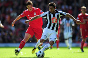 Fernando Torres of Liverpool competes for the ball with Gonzalo Jara of West Bromwich Albion during the Barclays Premier League match between Liverpool and West Bromwich Albion at Anfield on August 29, 2010 in Liverpool, England.