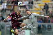 Djamel Mesbah of AS Livorno Calcio fights for the ball with Sebastien Frey of AC Chievo Verona during the Serie A match between AS Livorno Calcio and AC Chievo Verona at Stadio Armando Picchi on April 13, 2014 in Livorno, Italy.
