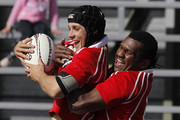 Daniel Harris of Poverty Bay is hugged by team mate Paulo Tikomainaivalu after scoring a try during the Lochore Cup Final match between South Canterbury and Poverty Bay at Alpine Energy Stadium on October 8, 2011 in Timaru, New Zealand.