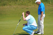 Paul Martin (R) and Nicholas Rogers (L) of Falmouth Golf Club line up a putt during the Lombard Trophy PGA National Pro-Am Championship Regional Final at Saunton Golf Club on June 07, 2013 in Devon, England.