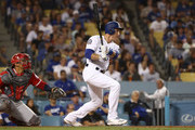 Chase Utley #26 of the Los Angeles Dodgers hits a single to right field in the fifth inning during the MLB game against the Los Angeles Angels of Anaheim at Dodger Stadium on July 13, 2018 in Los Angeles, California.