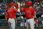 Albert Pujols #5 of the Los Angeles Angels of Anaheim congratulates Andrelton Simmons #2 for hitting a two run home run in the sixth inning against the Texas Rangers at Globe Life Park in Arlington on August 17, 2018 in Arlington, Texas.