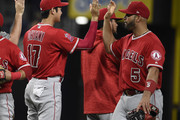 Shohei Ohtani #17 of the Los Angeles Angels high-fives Albert Pujols #5 after a baseball game against the San Diego Padres at PETCO Park on August 15, 2018 in San Diego, California.