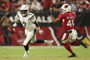 Quarterback Cardale Jones #7 of the Los Angeles Chargers scrambles with the football past defensive back Antoine Bethea #41 of the Arizona Cardinals during the preseason NFL game at University of Phoenix Stadium on August 11, 2018 in Glendale, Arizona.