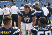 Philip Rivers #17 of the Los Angeles Chargers gives encouragement to Dan Feeney #66 and Mike Pouncey #53 in the closing moments of the their NFL game against the Buffalo Bills at New Era Field on September 16, 2018 in Buffalo, New York.