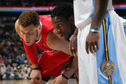 Kenneth Faried #35 of the Denver Nuggets and Blake Griffin #32 of the Los Angeles Clippers battle for position at Pepsi Center on April 18, 2012 in Denver, Colorado. The Clippers defeated the Nuggets 104-98. NOTE TO USER: User expressly acknowledges and agrees that, by downloading and or using this photograph, User is consenting to the terms and conditions of the Getty Images License Agreement.
