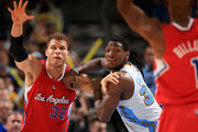 Blake Griffin #32 of the Los Angeles Clippers and Kenneth Faried #35 of the Denver Nuggets battle for position at the Pepsi Center on March 7, 2013 in Denver, Colorado. NOTE TO USER: User expressly acknowledges and agrees that, by downloading and or using this photograph, User is consenting to the terms and conditions of the Getty Images License Agreement.