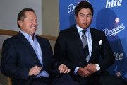 Hyun-Jin Ryu (R) sits with agent Scott Boras at a press conference introducing him following his signing with the Los Angeles Dodgers at Dodger Stadium on December 10, 2012 in Los Angeles, California.