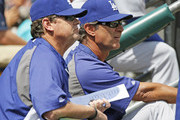 Manager Don Mattingly #8 of the Los Angeles Dodgers (R) and pitching coach Rick Honeycutt #40 watch from the dugout during an interleague game against the Detroit Tigers at Comerica Park on July 9, 2014 in Detroit, Michigan.