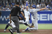 Chase Utley #26 of the Los Angeles Dodgers is tagged out by Freddy Galvis #13 of the San Diego Padres as he tries to steal second base during the third inning of a baseball game at PETCO Park on July 12, 2018 in San Diego, California.
