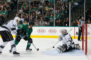 Cody Eakin #20 of the Dallas Stars shoots the puck against Jonathan Quick #32 of the Los Angeles Kings as Robyn Regehr #44 of the Los Angeles Kings defends in the third period at American Airlines Center on November 22, 2014 in Dallas, Texas.