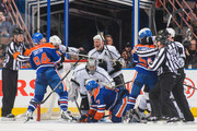 Members of the Edmonton Oilers mix it up after the whistle against the Los Angeles Kings during an NHL game at Rexall Place on April 10, 2014 in Edmonton, Alberta, Canada. The Kings defeated the Flames 3-0.