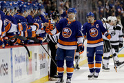 Josh Bailey #12 of the New York Islanders celebrates his goal with teammates on the bench as does John Tavares #91 who got the assist on the play in the first period against the Los Angeles Kings  on December 16, 2017 at Barclays Center in the Brooklyn borough of New York City.