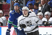 """Erik Gudbranson #44 of the Vancouver Canucks and Adrian Kempe #9 of the Los Angeles Kings skate up ice during their NHL game at Rogers Arena December 30, 2017 in Vancouver, British Columbia, Canada.  (Photo by Jeff Vinnick/NHLI via Getty Images)""""n"""