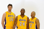 Kobe Bryant #24,  Pau Gasol #16 and Derek Fisher #2 of the Los Angeles Lakers pose for a photograph during Media Day at the Toyota Center on September 25, 2010 in El Segundo, California. NOTE TO USER: User expressly acknowledges and agrees that, by downloading and/or using this Photograph, user is consenting to the terms and conditions of the Getty Images License Agreement.