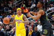 Isaiah Thomas #7 of the Los Angeles Lakers reacts after drawing a foul from Isaiah Taylor #22 of the Atlanta Hawks at Philips Arena on February 26, 2018 in Atlanta, Georgia.  NOTE TO USER: User expressly acknowledges and agrees that, by downloading and or using this photograph, User is consenting to the terms and conditions of the Getty Images License Agreement.