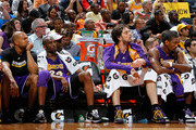(L-R) Derek Fisher #2, Kobe Bryant #24, Pau Gasol #16 and Ron Artest #37 of the Los Angeles Lakers look on from the bench in the final minutes of the game against the Atlanta Hawks at Philips Arena on March 31, 2010 in Atlanta, Georgia.  NOTE TO USER: User expressly acknowledges and agrees that, by downloading and/or using this Photograph, User is consenting to the terms and conditions of the Getty Images License Agreement.