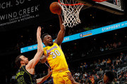 Julius Randle #30 of the Los Angeles Lakers attacks the basket against Miles Plumlee #18 and Andrew White III #4 of the Atlanta Hawks at Philips Arena on February 26, 2018 in Atlanta, Georgia.  NOTE TO USER: User expressly acknowledges and agrees that, by downloading and or using this photograph, User is consenting to the terms and conditions of the Getty Images License Agreement.