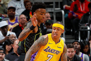 Isaiah Thomas #7 of the Los Angeles Lakers spins against John Collins #20 of the Atlanta Hawks at Philips Arena on February 26, 2018 in Atlanta, Georgia.  NOTE TO USER: User expressly acknowledges and agrees that, by downloading and or using this photograph, User is consenting to the terms and conditions of the Getty Images License Agreement.