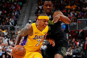 Isaiah Thomas #7 of the Los Angeles Lakers draws a foul as he drives against Isaiah Taylor #22 of the Atlanta Hawks at Philips Arena on February 26, 2018 in Atlanta, Georgia.  NOTE TO USER: User expressly acknowledges and agrees that, by downloading and or using this photograph, User is consenting to the terms and conditions of the Getty Images License Agreement.