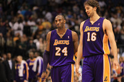 Kobe Bryant #24 and Pau Gasol #16 of the Los Angeles Lakers react after a 96-91 win against the Dallas Mavericks at American Airlines Center on March 12, 2011 in Dallas, Texas.  NOTE TO USER: User expressly acknowledges and agrees that, by downloading and or using this photograph, User is consenting to the terms and conditions of the Getty Images License Agreement.