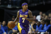 Isaiah Thomas #7 of the Los Angeles Lakers brings the ball up the court as the Lakers play the Dallas Mavericks in the second half at American Airlines Center on February 10, 2018 in Dallas, Texas. The Mavericks won 130-123.